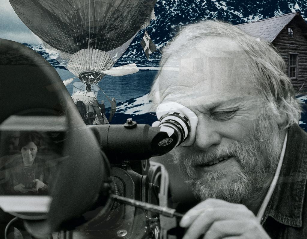 Filmaren och regissören Jan Troell tittar in i en filmkamera.